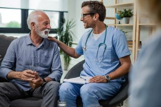 Man talking to a doctor about Benefits of TRT following Prostatectomy