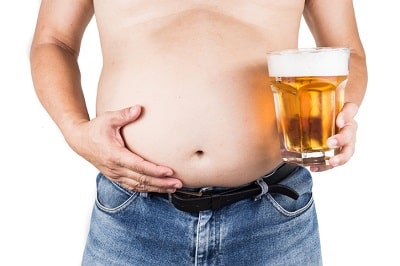 5 Foods That Lower Testosterone in Men and Grow Belly Fat - Fat man with beer